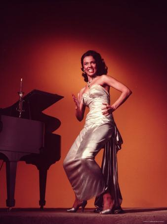 Singer and Actress Dorothy Dandridge Posing by a Piano