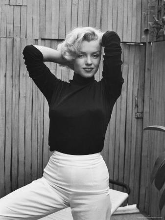 Actress Marilyn Monroe Playfully Elegant, at Home