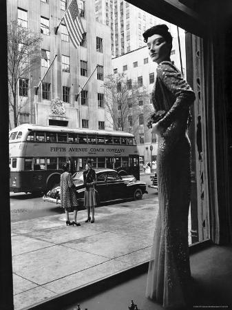 Women Standing on Sidewalk of 5th Avenue Across from Window of Saks Department Store