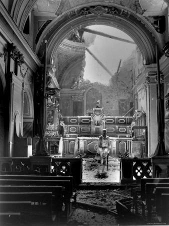 Pvt. Paul Oglesby, 30th Infantry, Standing in Reverence Before Altar in Damaged Catholic Church