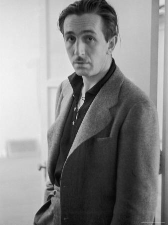 Candid Portrait of Movie Studio Head Walt Disney Standing in Doorway at Studio