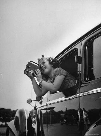 Child Actress Shirley Temple Taking Pictures of Famous Sites from Her Car