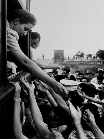 Eva Peron, Wife of Argentinean Presidential Candidate, Passing Out Campaign Buttons