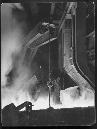 Female Metallurgist Peering Through an Optical Pyrometer to Determine the Temperature of Steel