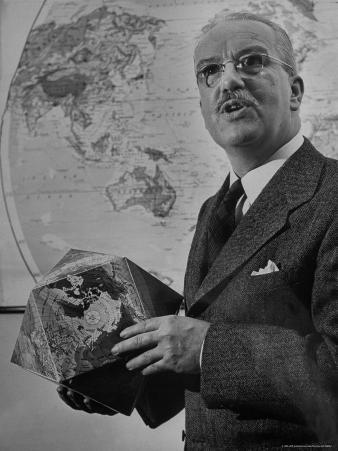 American Engineer and Architect Buckminster Fuller Holding a Globe