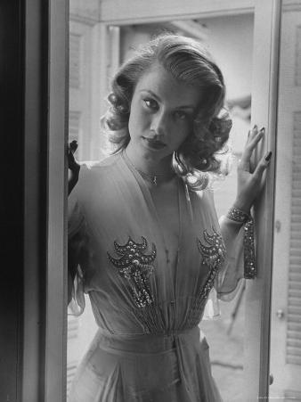 Actress Linda Christian in Gown with Plunging Neckline, Wearing Small Cross
