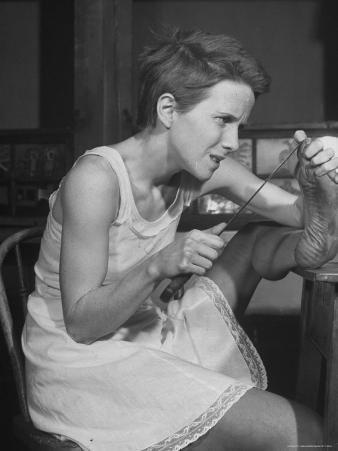 """Actress Julie Harris, Digging Splinter from Foot with Knife in Scene from """"Member of the Wedding"""""""