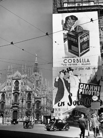 Billboard in the Piazza Del Duomo features Abbott and Costello, Whom Italians Call Cianni E Pinotto