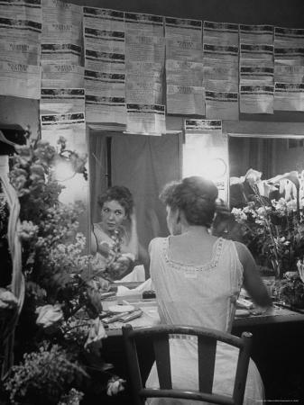 "Actress Geraldine Page backstage of ""Midsummer"" surrounded by telegrams and flowers"