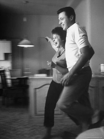 Husband and Wife Singers Steve Lawrence and Eydie Gorme Clowning in Their Apartment