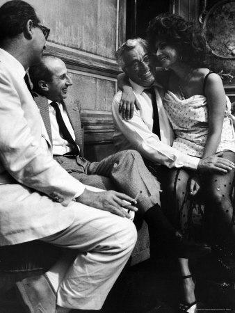 "Sophia Loren Sitting on Director Vittorio de Sica's Lap During Filming ""Marriage, Italian Style"""