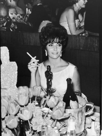 Actress Elizabeth Taylor at Hollywood Party After Winning Oscar, Which is on Table in Front of Her