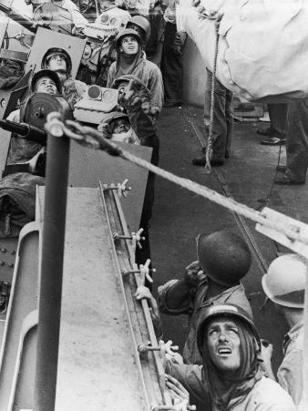 Crew Aboard Aircraft Carrier USS Hornet Peer Anxiously Skyward Watching for Kamikaze Planes
