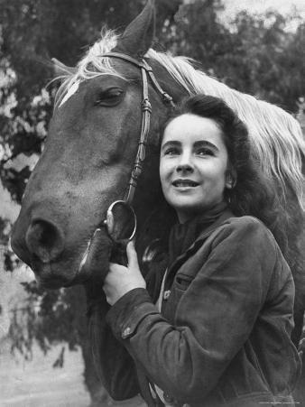 """Actress Elizabeth Taylor with Saddle Horse After Her Smash Movie Debut in """"National Velvet"""""""