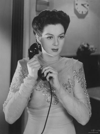 """Rosalind Russell Taking Important Call in Romantic Comedy Action Movie """"They Met in Bombay."""""""
