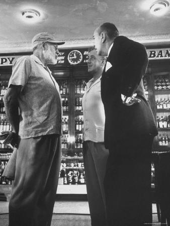 Noel Coward Chatting with Ernest Hemingway and Alec Guinness on Set Location at Sloppy Joe's Bar