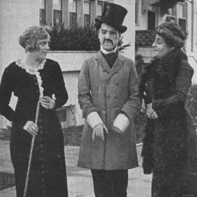 "Charlie Chaplin with Virginia Kirtby and Alice Davenport in ""Making a Living."""