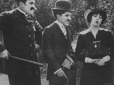"Charlie Chaplin with Mabel Normand in Film ""Getting Acquainted."""