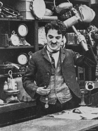 Charlie Chaplin Hitting His Head with Wooden Mallet in The Floorwalker