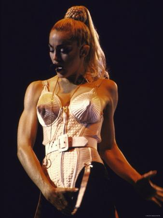 Pop Star Madonna Wearing Conical Bustier and Standing in Provocative Pose While Onstage