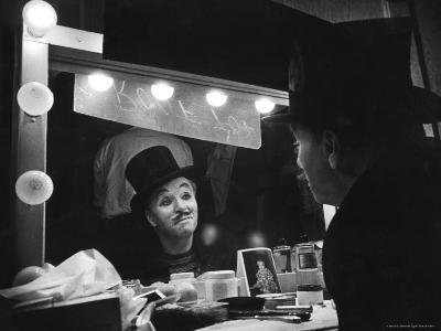 Charlie Chaplin Looking Into Mirror, Putting on Makeup for Role as the Animal Trainer