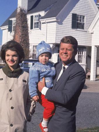 Presidential Candidate John F. Kennedy Holding Daughter with Wife Outside Home on Election Day