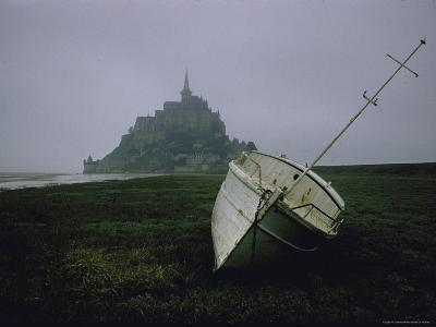 Boat and Mont St. Michel, Islet in Northwestern France, in the Gulf of Saint Malo