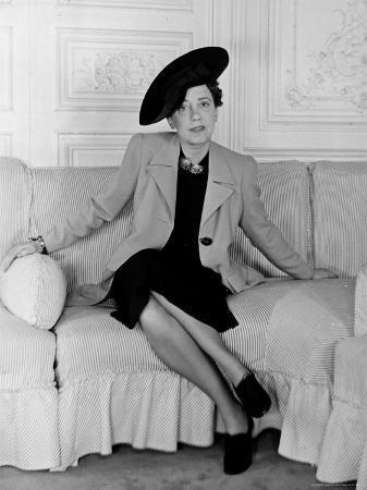"Elsa Schiaparelli, Wearing the New Napoleon Hat and Jacket of Magenta Called ""Shocking."""