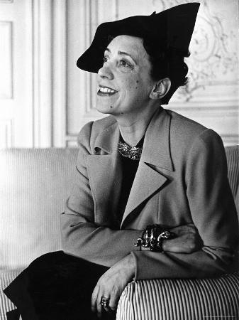 """Elsa Schiaparelli Wearing a Jacket of Her New Magenta Color Known as """"Shocking."""""""
