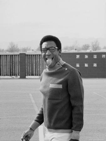 Comedian Bill Cosby Sticking His Tongue Out During Game of Basketball