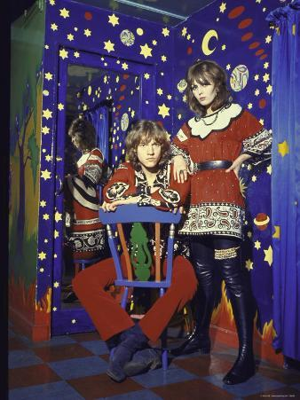 Pair of Long Haired Londoners in a Psychedelic Corner of the Beatles' Apple Boutique