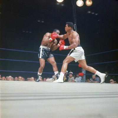 "Cassius Clay, aka Muhammad Ali Throwing Famous ""Phantom Punch"""