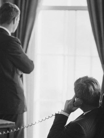 Pres. John F. Kennedy on Telephone While Brother, Attorney General Robert F. Kennedy Stands Nearby