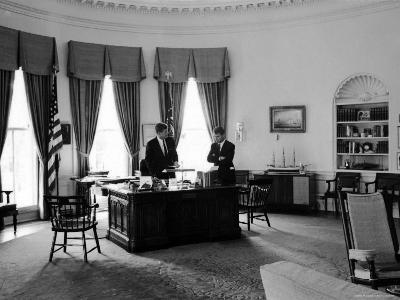 President John F. Kennedy in Oval Office with Brother, Attorney General Robert F. Kennedy