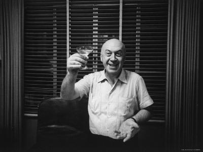"""Otto Preminger Raising Champagne Glass in Hollywood Office During """"Anatomy of a Murder."""""""