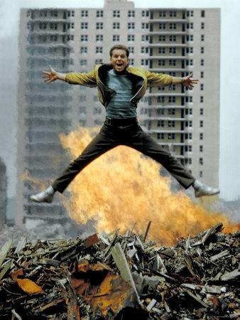 Riff Leaps over Smoldering Rubble of New York Slum Clearance Project in Scene from West Side Story