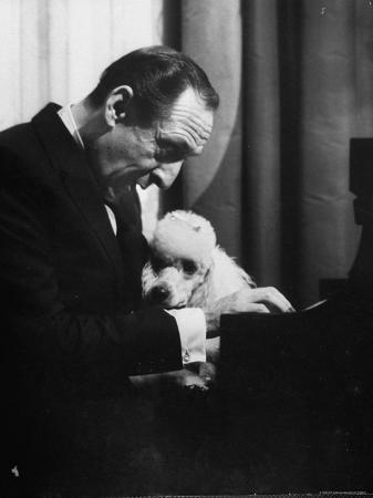 Vladimir Horowitz at the Piano with Poodle