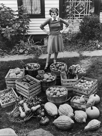 Woman Looking at Victory Garden Harvest Sitting on Lawn, Waiting to Be Stored Away for Winter