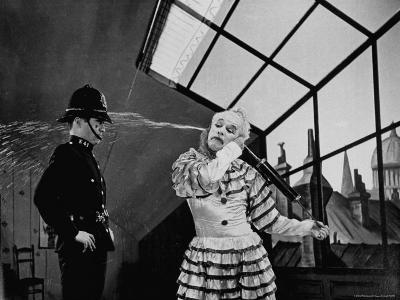 Charlie Chaplin Squirting Water Into Face of Policeman, Scene from Limelight