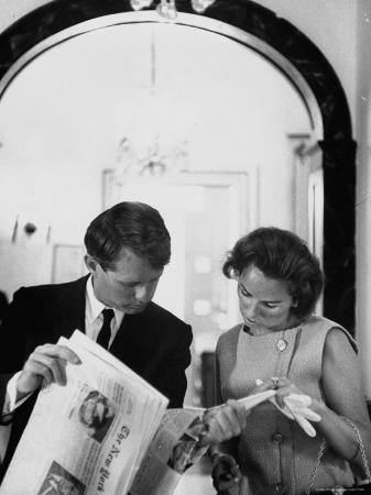 Attorney General Robert Kennedy and Wife Looking at Copy of the New York Times