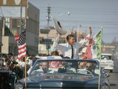Republican Gubernatorial Candidate Ronald Reagan Waving in Convertible Car While on Campaign Trail