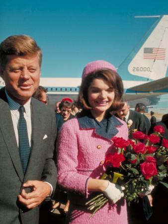 President John F. Kennedy Standing with Wife Jackie After Their Arrival at the Airport