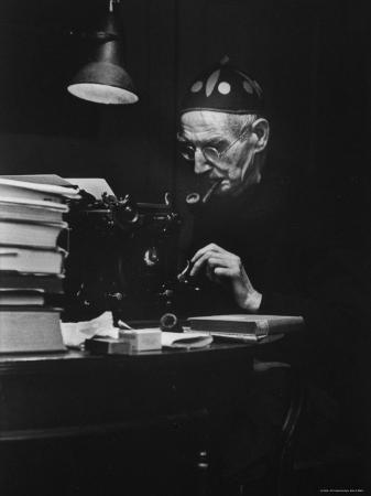 Irish Playwright Sean O'Casey with Pipe in His Mouth as He Works at His Typewriter at Home