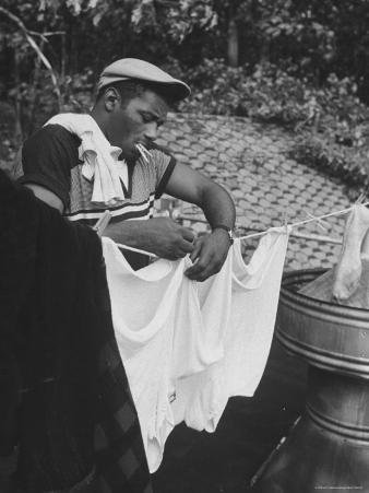 Boxer Floyd Patterson Doing Laundry at Training Quarters Near Newtown