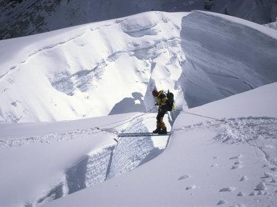 Mountaineer Crossingover a Crevase in the Khumbu Ice Fall, Nepal