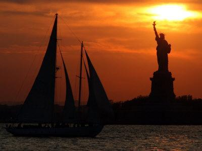 The Sun Sets Behind the Statue of Liberty on the Longest Day of the Year