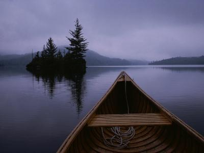A Canoe Ride on a Cloudy Morning on a Quite Lake