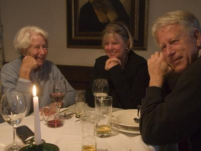 A Family Sits Around the Dinner Table at a Restaurant, Fraueninsel, Chiemsee, Bavaria, Germany