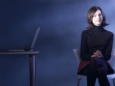 Woman Sitting Beside Table with Laptop