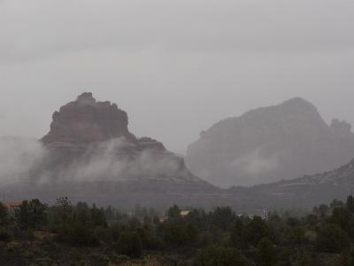 Misty Rain Clouds Swirling Around Red Rocks in Sedona